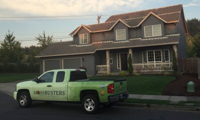 Moss Busters truck in front of home